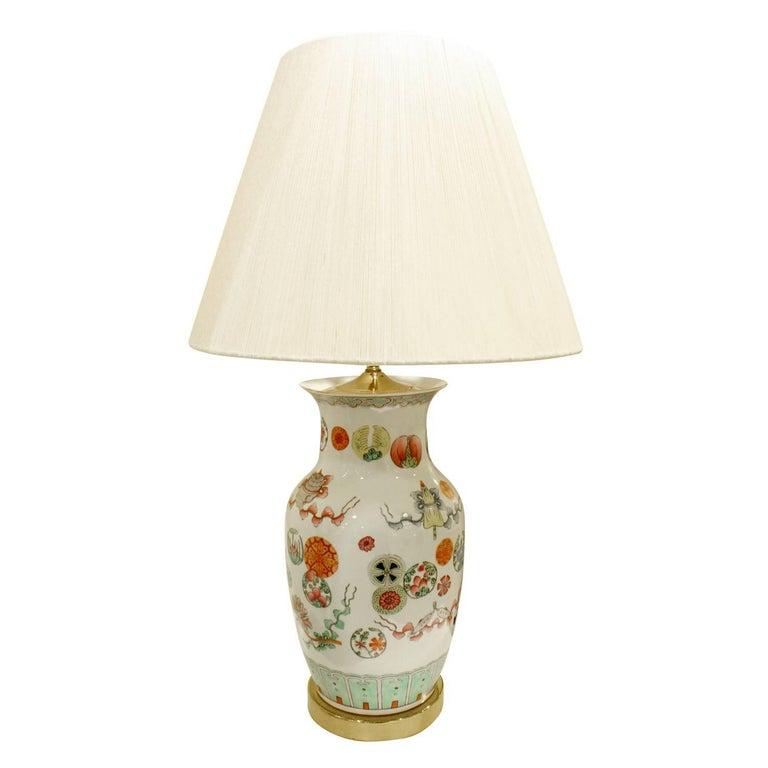 Exceptional hand-painted porcelain table lamp with flowers, medallions and geometric decoration with brass base and custom fittings, China, 1960s.