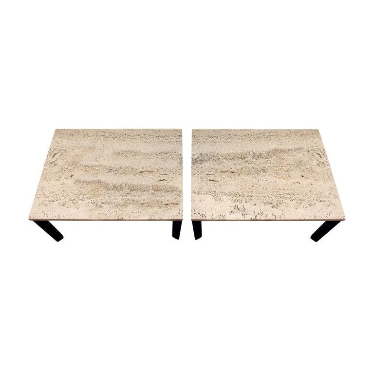Pair of angular leg coffee tables, dark mahogany bases with travertine tops, American, 1950s.