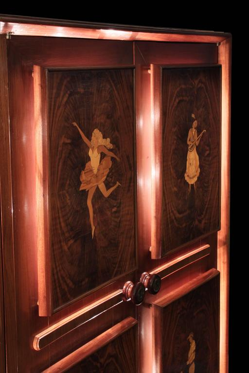 Hand-Carved Illuminated Four-Door Cabinet with Figural Inlays by Eugenio Diez For Sale