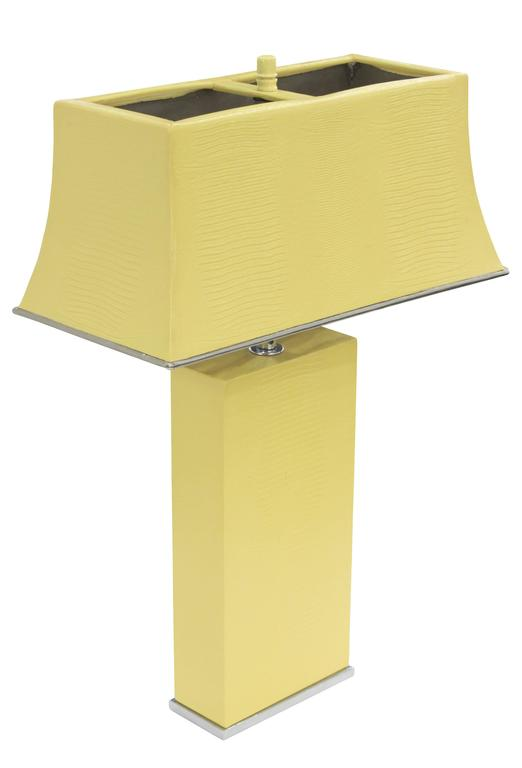 "Exceptional table lamp with shade, both in steel clad in yellow embossed lizard leather, by Karl Springer, American 1974. Height is adjustable from 22"" to 26""."