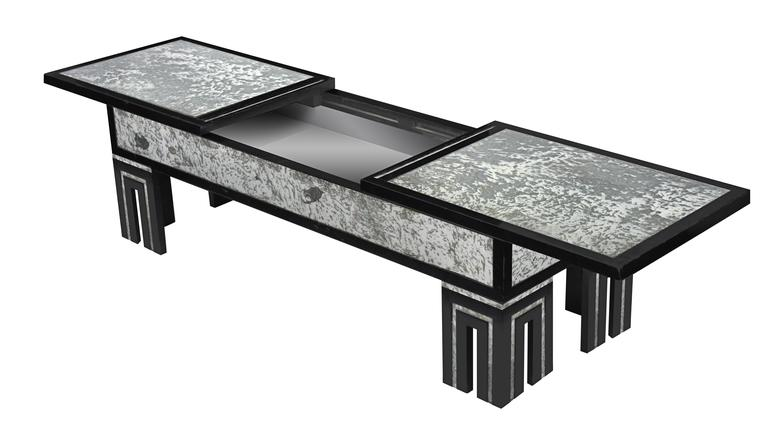 Ebonized coffee table with mottled antique glass and retractable top by James Mont, American, 1940s. Table is 68 inches wide when top is fully opened.