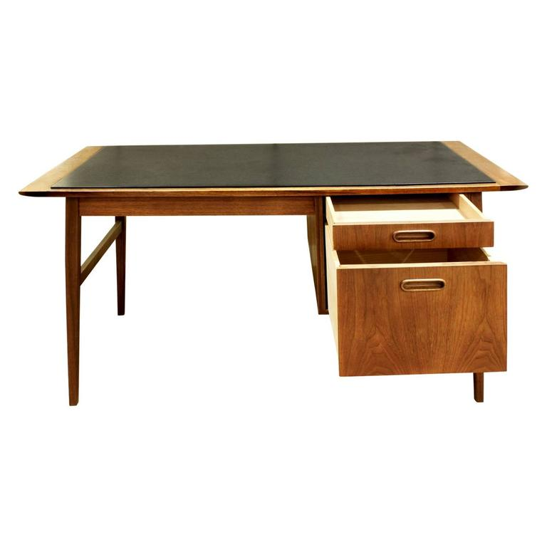Deak in teak with drawers with inset pulls and inset micarta top, Denmark, 1960s. The micarta is speckled dark gray.