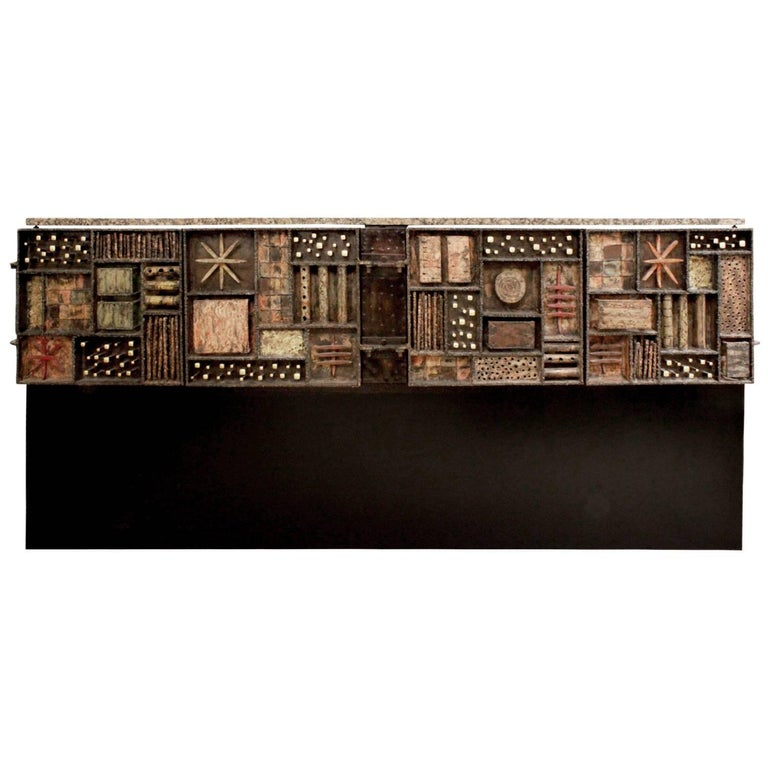 Forged front four-door cabinet in welded and patinated steel, color pigments, 24-karat gold leaf, painted wood with granite top by Paul Evans, American 1979. This piece comes with the original invoice from The Paul Evans Studio. It was designed for