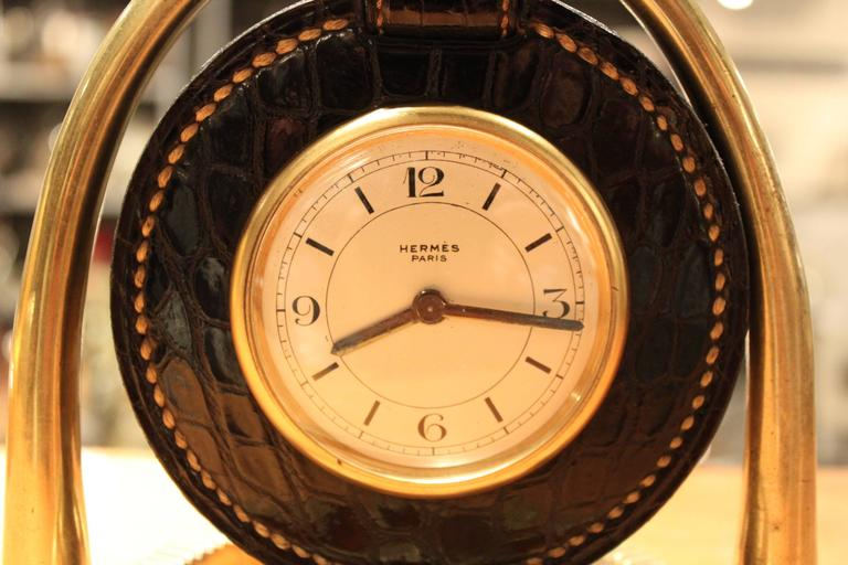 This Clock was designed in the 1940's by Paul Dupre Lafon for Hermes. To find this clock in Black crocodile is exceedingly rare. It has an 8 day movement, the condition of the croc is amazing, and the dial is gorgeous.
