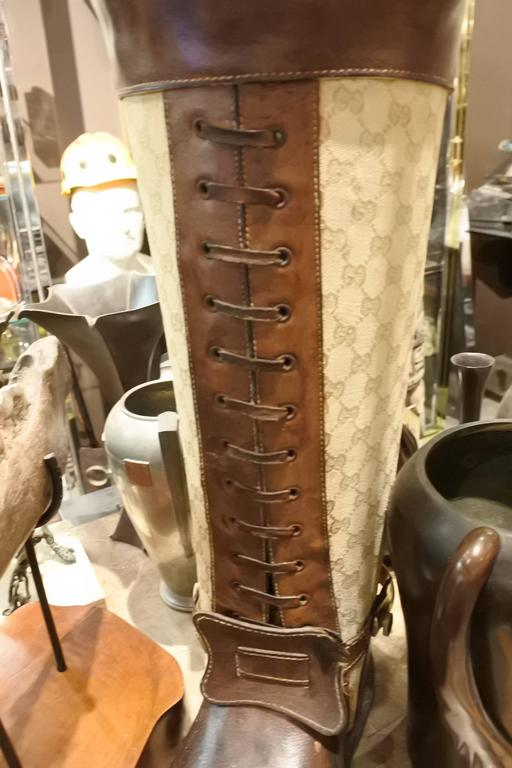 In our entire career, we have only seen one other. From 1960s Gucci boutique, this giant boot umbrella stand is leather and fabric and lined in metal. Amazing for decor or an actual umbrella stand.