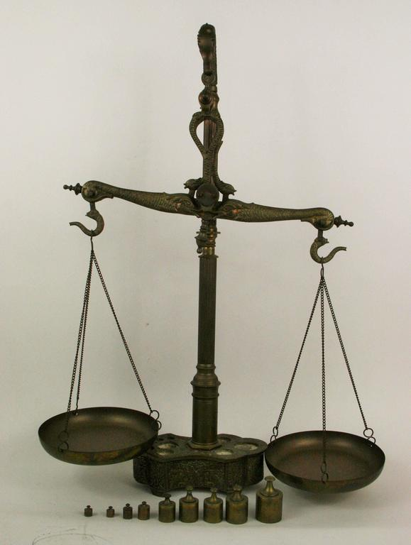 9-176 Intricately detailed brass balance scale with weights (weights fit in solid brass base) made in Portugal.