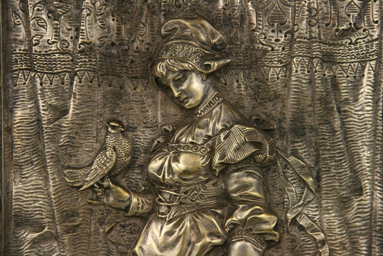 9-00 bronze wall plaque of a Victorian lady with her dog.