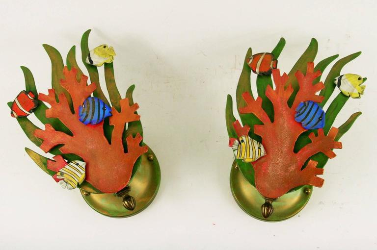 2-1817. Pair of handmade and painted sconces, Takes one 60 watt bulb. NO ADDITIONAL DISCOUNTS ON SALE ITEM