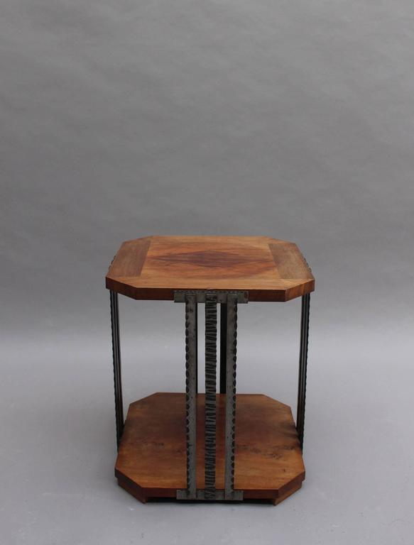 A fine French Art Deco two-tiered gueridon or side table with four triple wrought iron stems legs that support a walnut marquetry top.
