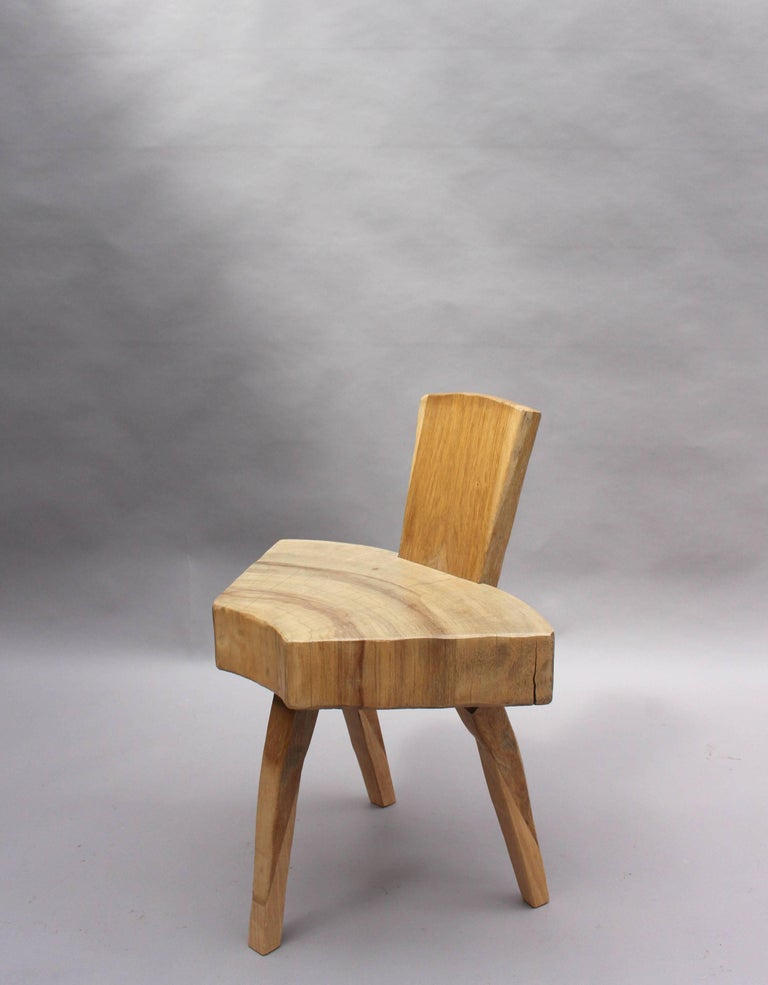 Set of four 1950s organic oak chairs with a tree trunk slice seat on three legs and metal details.