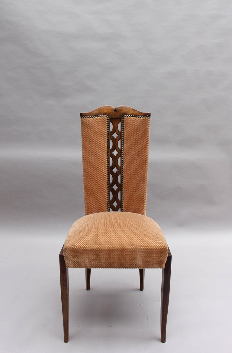 A set of eight French Art Deco dining chairs with wooden tracery on the center back.