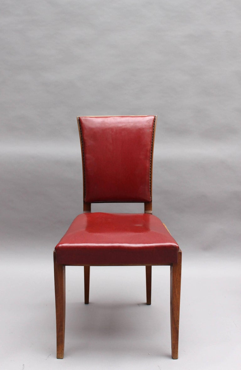 Set of six fine French Art Deco walnut dining chairs by Maxime Old.