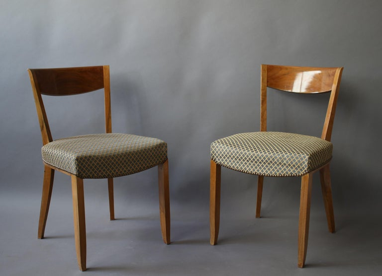 A set of twelve fine French Art Deco walnut dining chairs by Jules Leleu.