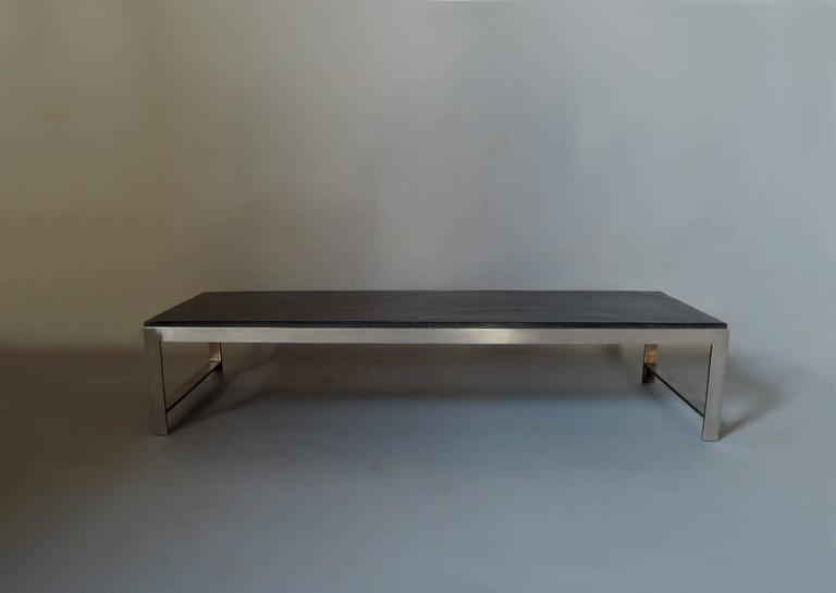 A large fine French 1970's stainless steel base coffee table with a dark slate top.