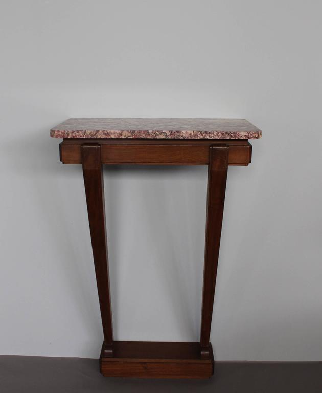 A fine French Art Deco console with a mahogany pedestal and a marble top. A thinner pair of matching console is also available (Ref: LU78484963903)