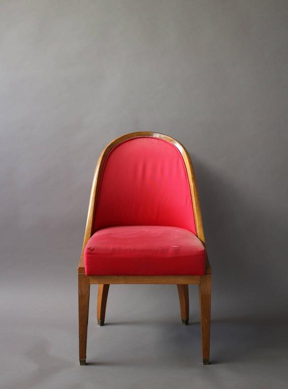 A fine French Art Deco gondola armchair with brass details.