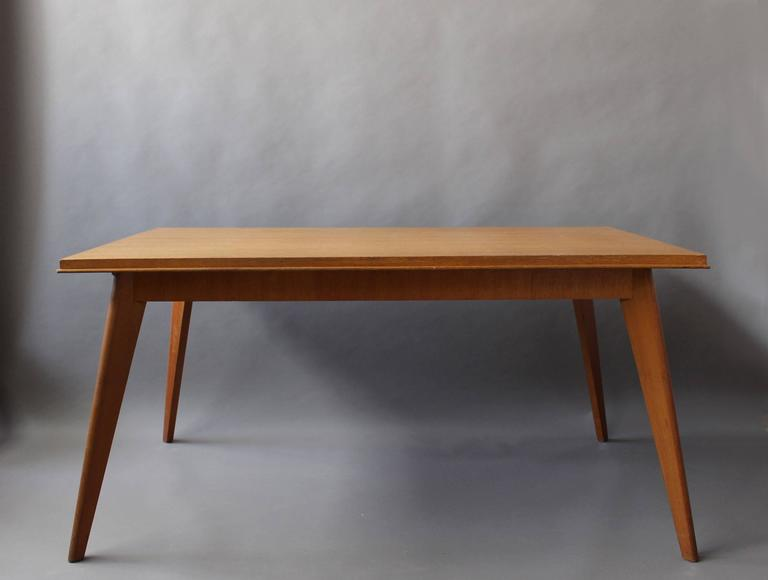 A Fine French mid-century compass legs oak dining / writing table with 2 raw wood end extensions (15 3/4