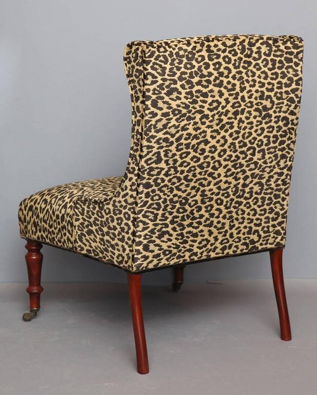 The madeleine slipper chair. Upholstered slipper chair with tight seat and back. Front turned legs with small casters. Solid hardwood construction. Made to order. Available in seven specialty finishes including cerused as shown.