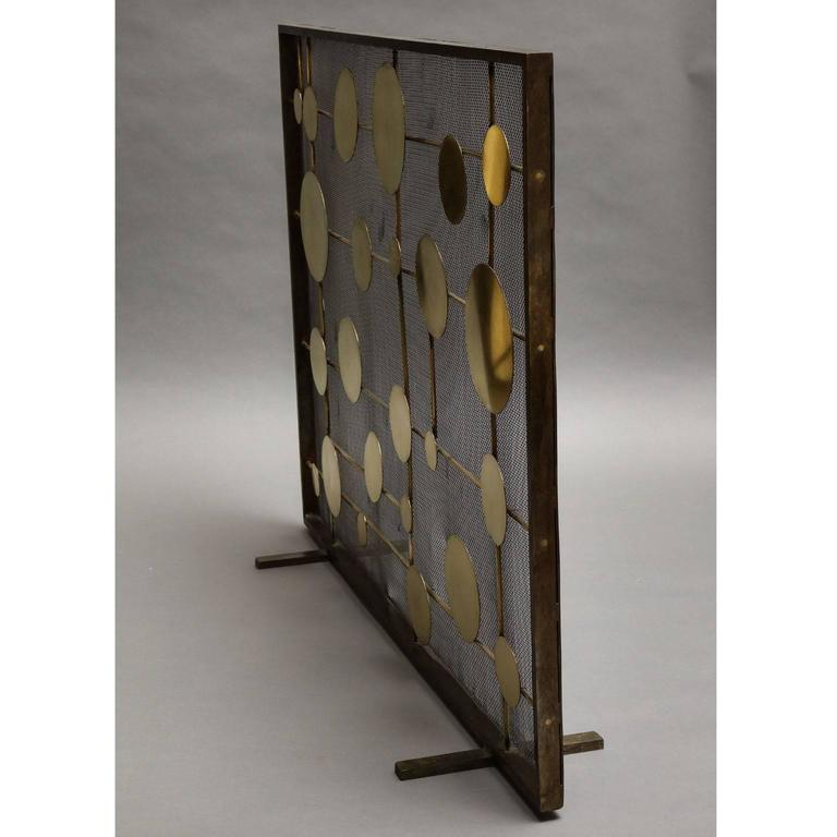 """Marie Suri """"Cirque"""" fire screen Fire screen with scattered brass disks mounted on brass rods. Mesh backing makes these an excellent choice for wood-burning fireplaces. Custom inquiries welcome. Made to order expressly for Liz"""
