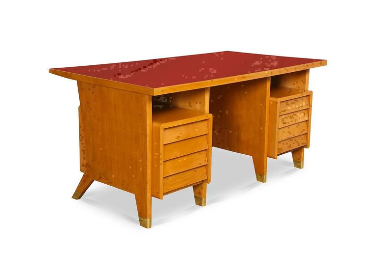 Gio Ponti custom eight-drawer desk.  From a small edition created for administrative offices in Forli, Italy. Blonde wood desk with red linoleum top, shingled drawer faces and brass cuffs at feet. A great, graphic form that rarely turns up.