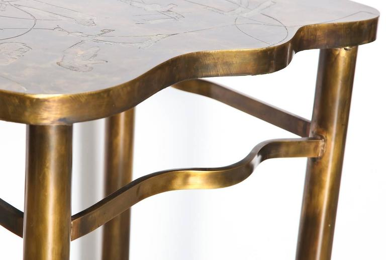 Take the A Train, unique table by Philip & Kelvin LaVerne.  Incredible free-form bronze top with abstract, acid-etched decoration and torched finish. Four cylinder bronze legs with irregular formed stretchers. Etched signature to top edge. A