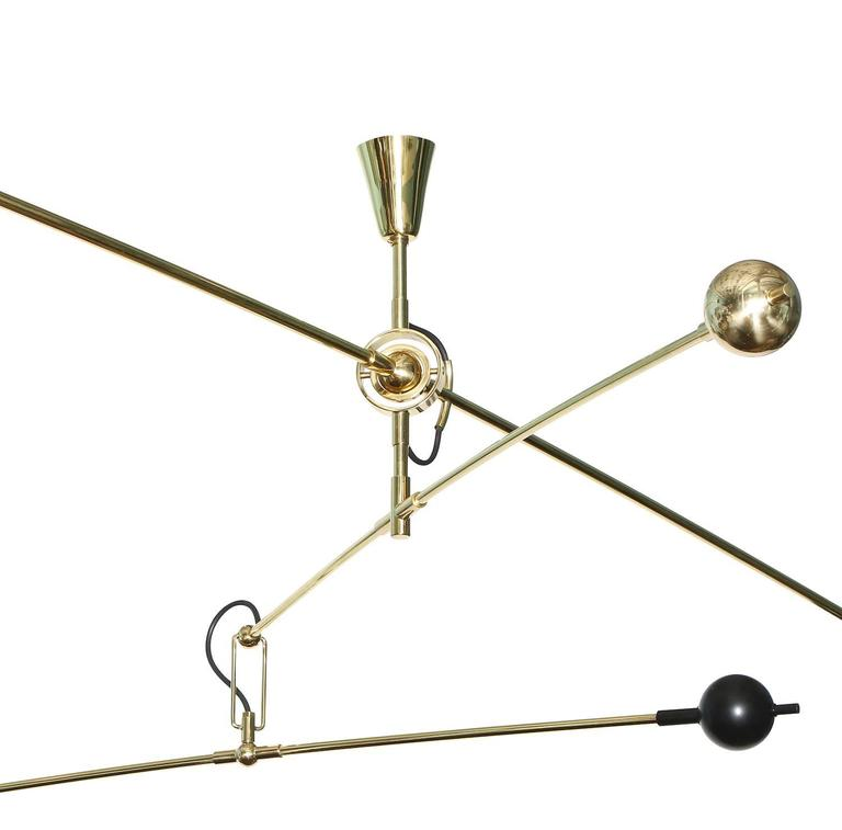 """Studio-made two-light """"Mobile"""" fixture by Fedele Papagni.  Sculptural fixture with three moving arms and counterbalance orbs suspended by pivoting joints.  Polished and black-painted brass elements and custom, black-painted aluminum"""