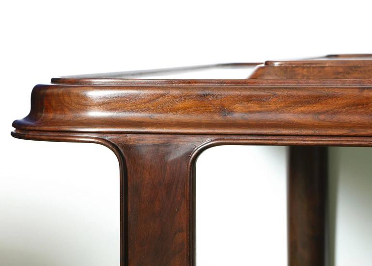 Paul Laszlo large-scale low table with rounded corners, two-level burl wood top and finely crafted detailing. This unique table was created for a Bel Air home and appears to have never been repeated in any other Laszlo commission. *Published: