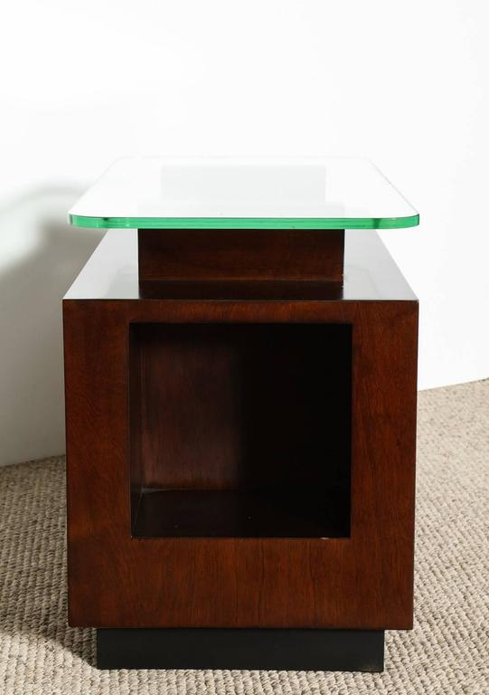 Paul Laszlo, rare custom side table. Paul Laszlo, dark stained wood and architectural form with front cut-out. Two top supports hold a thick floating glass top. From a private residence in Beverly Hills, CA.