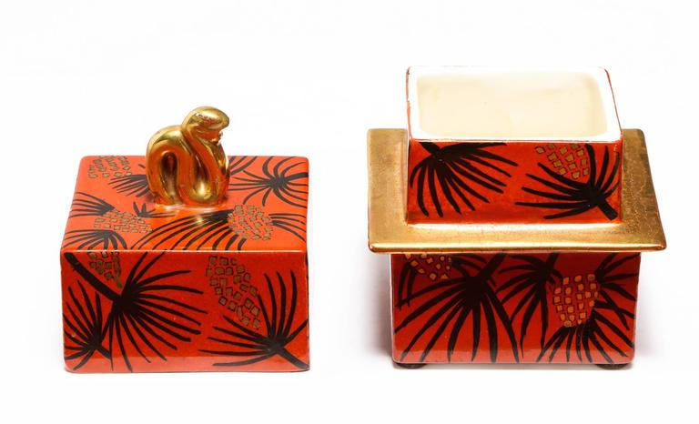 Lidded box by Gio Ponti for Richard Ginori. Square-shaped porcelain box with lid. Glazed in red and black with palm frond motif. Signed and dated on underside. Publication: Gio Ponti: alla manifattura di Doccia, pg. 69 & 99 for illustrations and