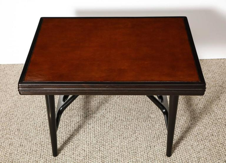 Architectural structure in black stained wood with inset rust-colored leather top. A very rare Laszlo form, most probably a one off design.