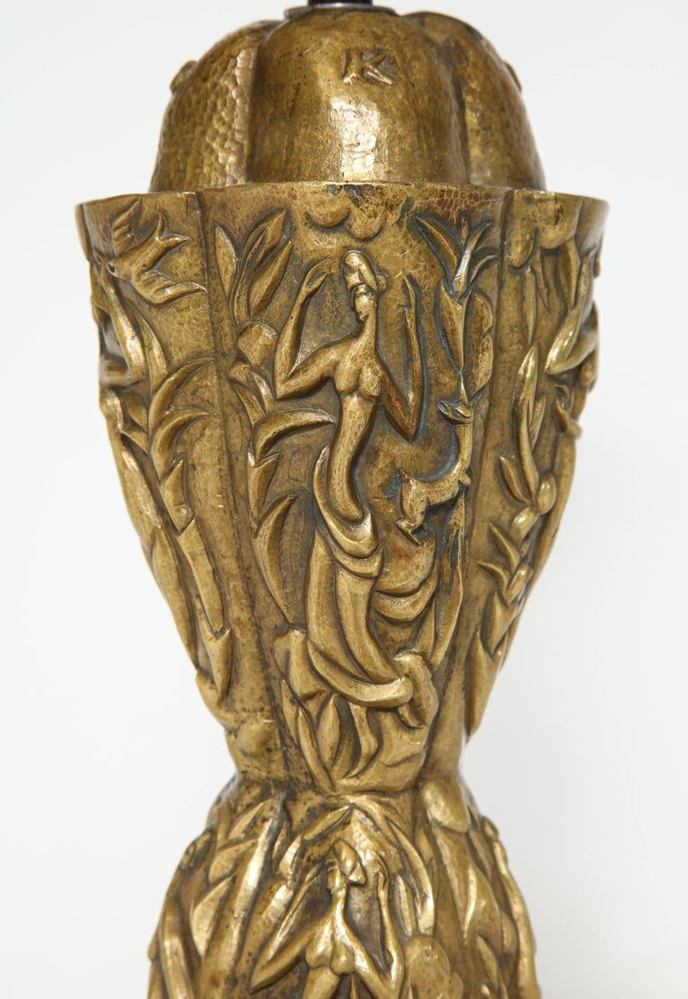 Unique studio made table lamp by Karl Hagenauer. Incredible hand worked base with hand-repoussé figures and shapes throughout. An outstanding example of the studio work of Hagenauer Werkstatte. Artist's initials and date embossed at top.
