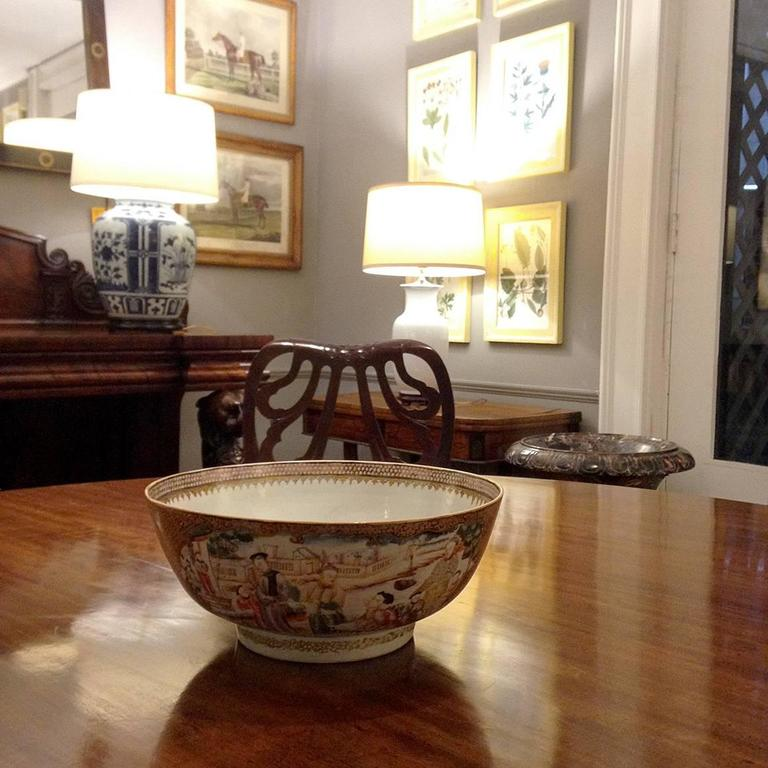 This finely decorated Qing-period rose medallion or rose mandarin bowl is beautifully hand-painted with four vignettes depicting courtly scenes.