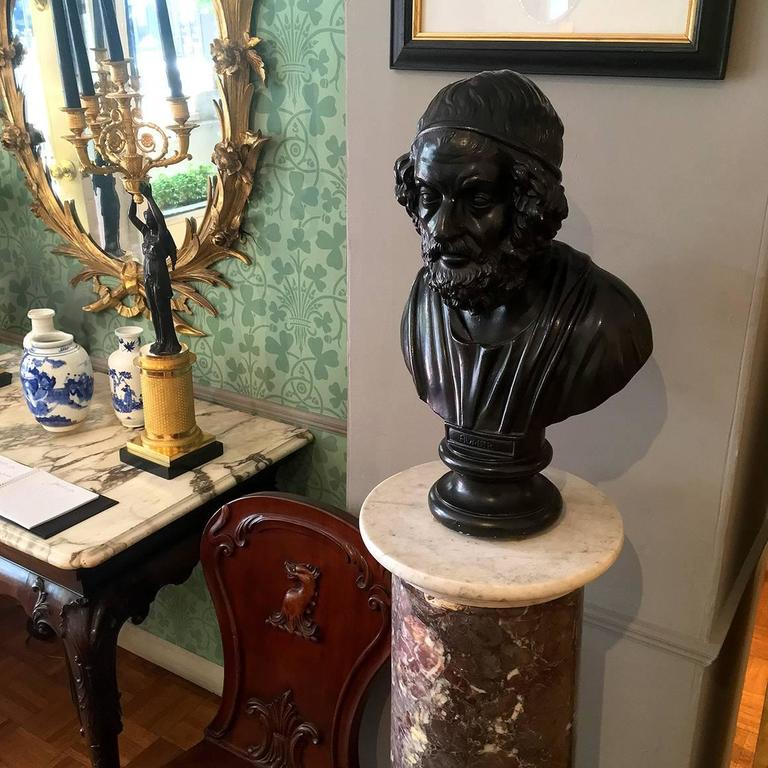 This early 19th century plaster bust of Homer is sculpted and painted in resemblance of the 18th century basaltware bust of the ancient Greek poet that was produced by Wedgwood in Staffordshire.