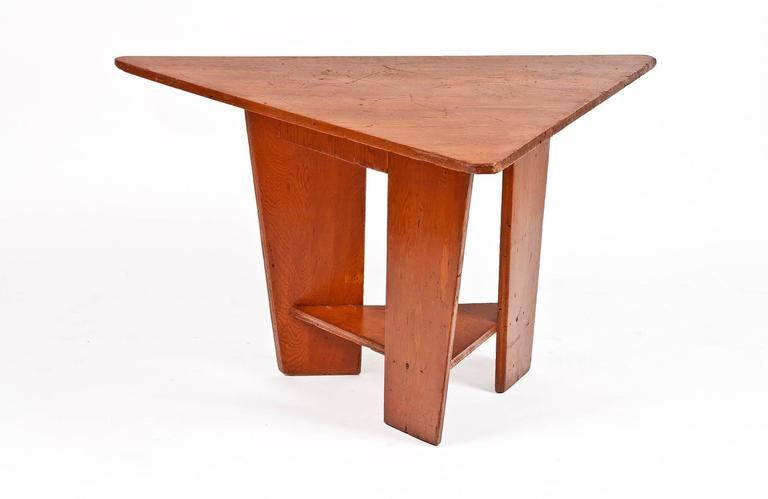 This trio of hinged bench seats and one table were designed by Frank Lloyd Wright and completed in 1951 for the Unitarian Meeting House, which Wright also designed, at 900 University Bay Drive, Shorewood Hills, Madison, Wisconsin. The components of