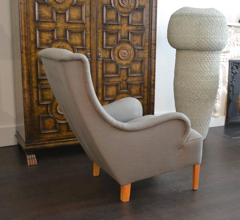 "Beautiful single sculptural lounge chair by Swedish master Carl Malmsten.  Carl Malmsten (1888-1972). Carl Malmsten Studio. Sweden, circa 1950. New Upholstery. Measures: 37.5"" H x 27"" W x 26.75"" D. Seat height: 18"