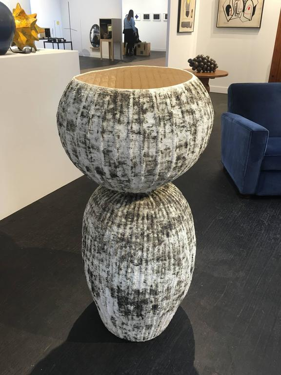 Bubble Urn lII B by Kristina Riska is a handbuilt ceramic urn created in the coil method. This modern sculptural form was created in 2015 for a special exhibit at the Finnish consulate in Washington, DC in September of 2015.  Kristina Riska is a