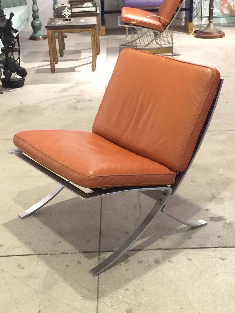Pair of Mid-Century Modern leather chairs with original upholstery in very good condition. Beautiful steel frame with. Perfect size chair for a lounge or living room area. Not too heavy to move around.