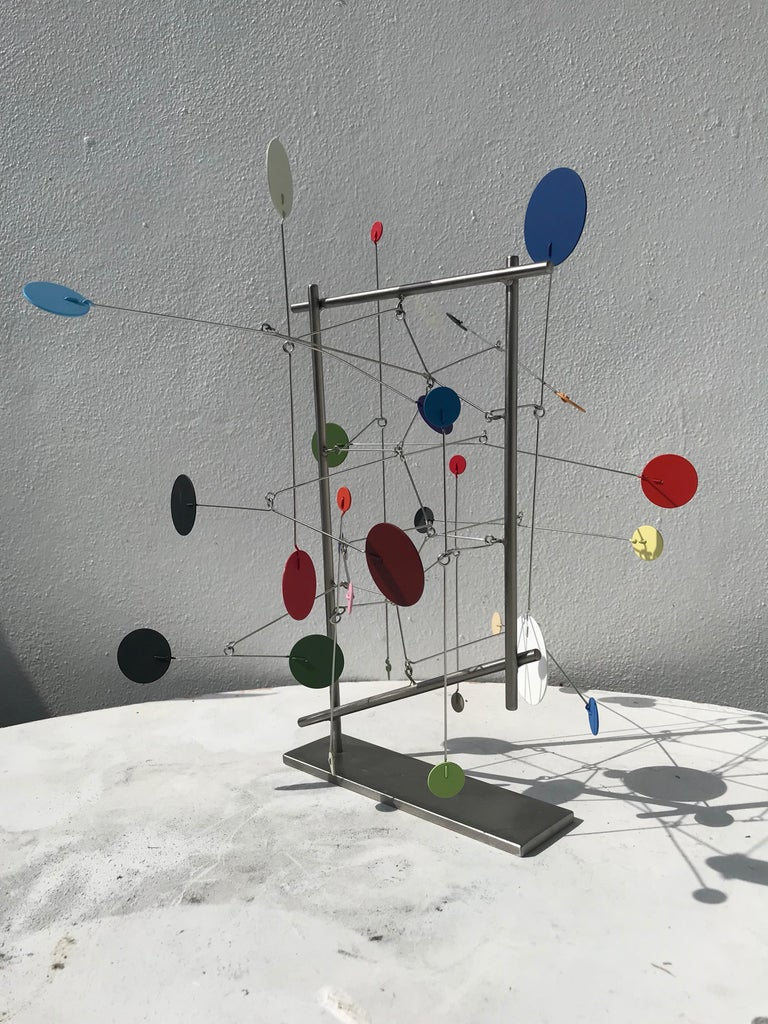A painted metal kinetic sculpture by