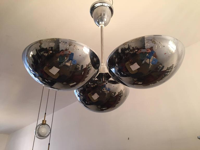 A great 1930s Bauhaus polished chrome flush ceiling light or hanging pendant. The fixture is composed of three half domes each with a porcelain 120w light socket. All rewired. Ceiling pole can be shortened or lengthened.