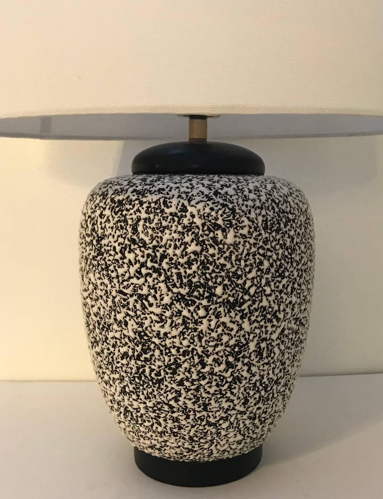 An iconic French Art Deco ceramic table lamp made by Paul Milet in Sevres France. The body of the lamp has a textured crispe technique giving a coral appearance. The top and bottom are a solid dark brown giving the lamp a very eye catching graphic