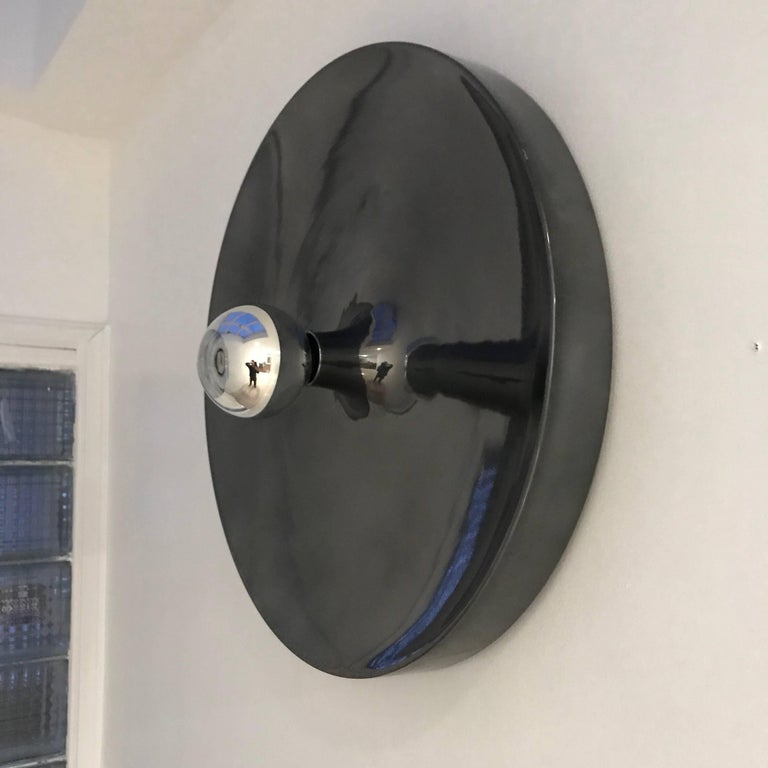 An extra large polished smoked grey with mirror enamel finish German Space Age flush ceiling light. Can be used on the wall or ceiling. Rewired. Standard base bulb. Made by Honsel Leuchten. French designer, Charlotte Perriand used the light in the