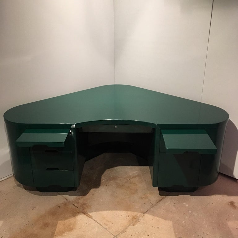 An iconic American Art Deco desk originally designed by Hughes Aircraft circa 1940 by Fletcher Aviation. An early model with a
