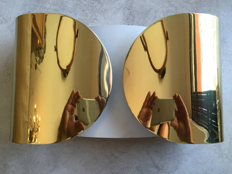A sleek pair of Space-Ave Italian midcentury wall lights by Tobia Scarpa. The wall lights are composed of golden polished brass with white enamel on the inside. Rewired. Three pairs available.