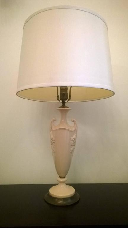 """A great pair of 1930s Art Deco cream/ flesh color table lamps with aged dark brass bases and fittings by the American china maker, Lenox. Rewired. Base height from the bottom of the base to the socket, 16""""."""