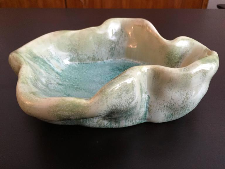 An original 1950s pale green with a slight crystalline glaze bowl by famed Italian artist, Antonia Campi. Signed.