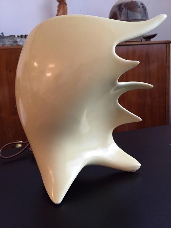 An original 1950s Conchiglia glazed ceramic lamp in the form of a conch shell.  Societa Ceramica Italiana di Laveno. Signed.