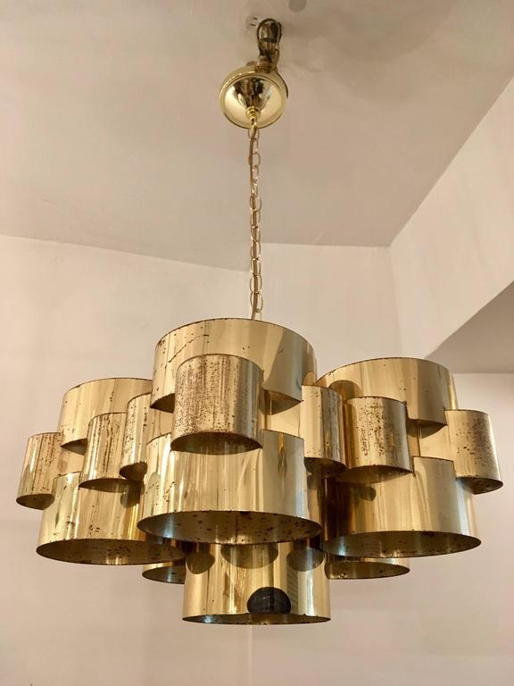 An original 1960s cloud pendant by Curtis Jere composed of circular polished brass components. Newly rewired. Original finish with pitting to the brass. We will include a new polish if desired. Signed.