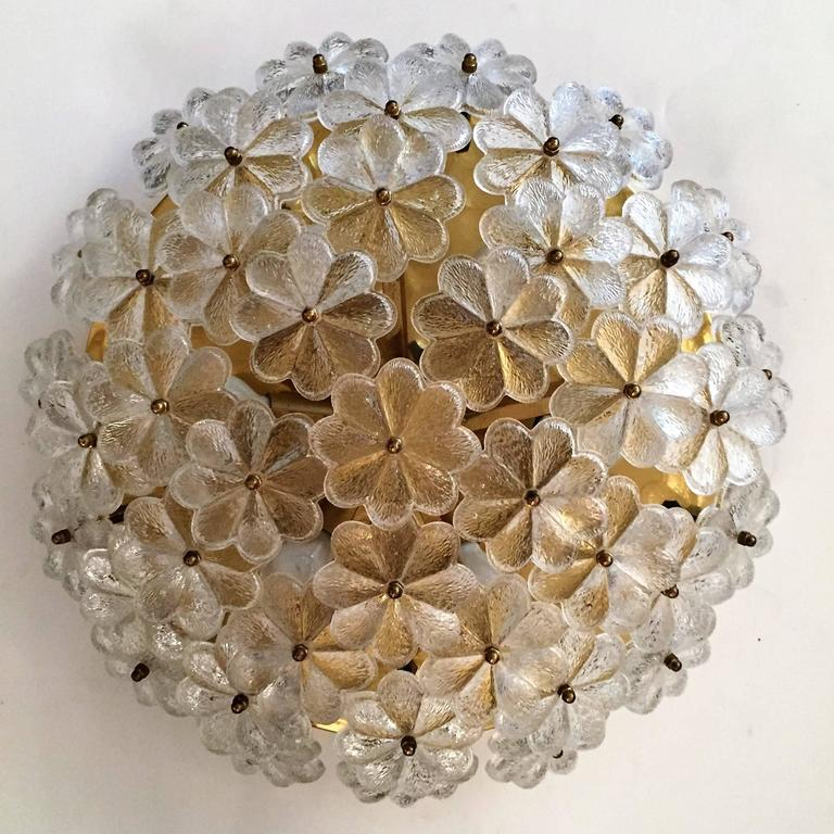 A wonderful 1960s Austrian flush ceiling light composed of a golden brass fixture holding 42 floral glass elements. Six-light sources. Newly rewired.