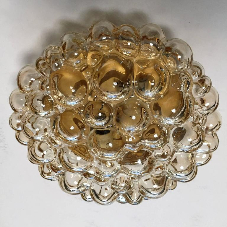 A wonderful pair of 1960s very light golden bubble glass round flush ceiling lights by Helena Tynell for Limburg glass. Two standard sockets. Rewired.