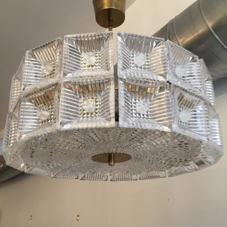 A wonderful original 1960s Swedish crystal hanging pendant or flush ceiling light designed by Carl Fagerlund for Orrefors. The light is composed of two rows of thick cut crystal square elements and one large circular crystal diffuser and polished